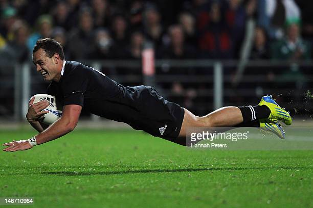 Israel Dagg of the All Blacks dives over to score during the International Test Match between New Zealand and Ireland at Waikato Stadium on June 23...