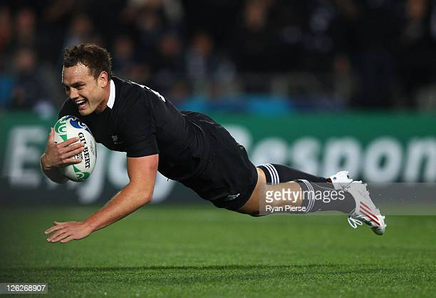 Israel Dagg of the All Blacks goes over to score their third try during the IRB 2011 Rugby World Cup Pool A match between New Zealand and France at...