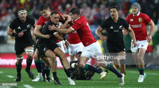 Israel Dagg of the All Blacks is held by Owen Farrell and Jonathan Sexton during the match between the New Zealand All Blacks and the British Irish...