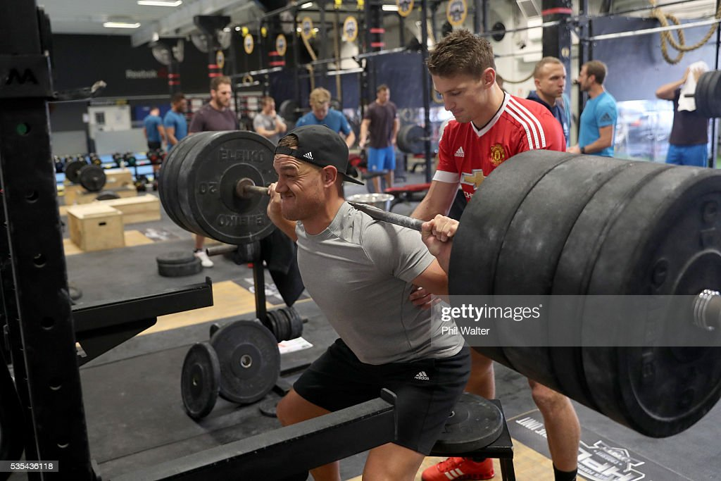 Israel Dagg of the All Blacks is spotted by Beauden Barrett during a gym session at Les Mills on May 30, 2016 in Auckland, New Zealand.