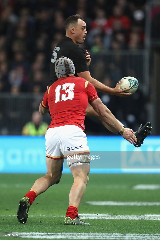 <a gi-track='captionPersonalityLinkClicked' href=/galleries/search?phrase=Israel+Dagg&family=editorial&specificpeople=2086281 ng-click='$event.stopPropagation()'>Israel Dagg</a> of the All Blacks is tackled by <a gi-track='captionPersonalityLinkClicked' href=/galleries/search?phrase=Jonathan+Davies+-+Rugby+Union+Player+-+Born+1988&family=editorial&specificpeople=8522336 ng-click='$event.stopPropagation()'>Jonathan Davies</a> of Wales during the International Test match between the New Zealand All Blacks and Wales at Forsyth Barr Stadium on June 25, 2016 in Dunedin, New Zealand.