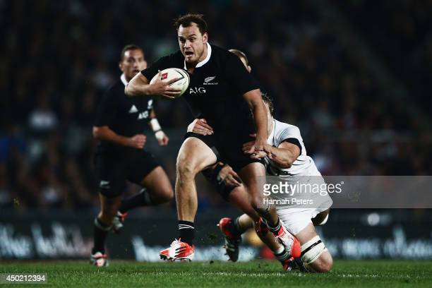 Israel Dagg of the All Blacks makes a break during the International Test Match between the New Zealand All Blacks and England at Eden Park on June 7...