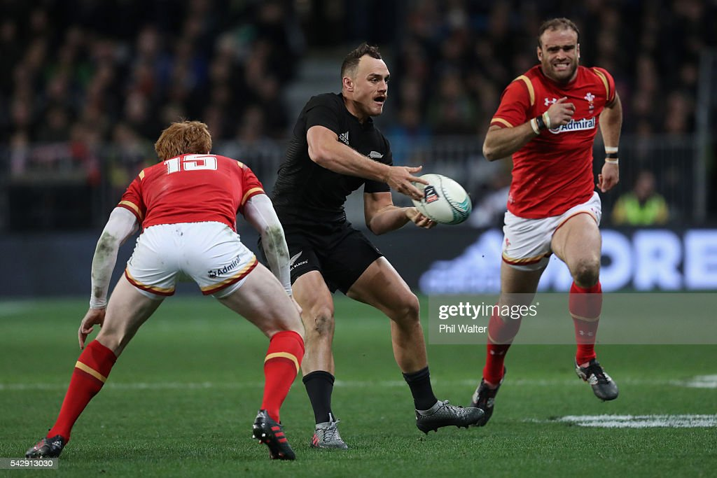 Israel Dagg of the All Blacks passes during the International Test match between the New Zealand All Blacks and Wales at Forsyth Barr Stadium on June 25, 2016 in Dunedin, New Zealand.