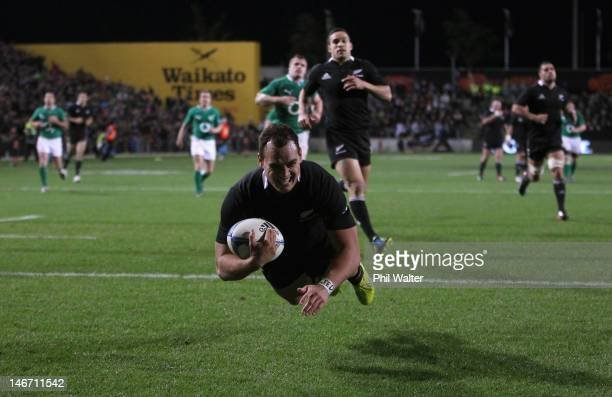 Israel Dagg of the All Blacks scores a try during the International Test Match between New Zealand and Ireland at Waikato Stadium on June 23 2012 in...