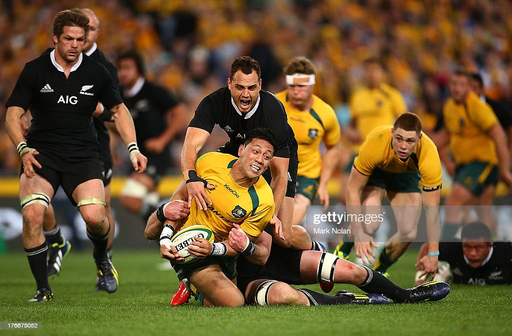 Israel Dagg of the All Blacks tackles Christian Leali'ifano of the Wallabies during The Rugby Championship Bledisloe Cup match between the Australian...