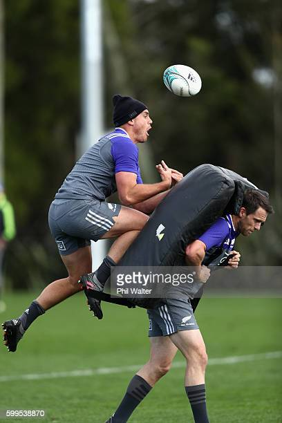 Israel Dagg of the All Blacks takes the high ball over Ben Smith during a New Zealand All Blacks training session on September 6 2016 in Hamilton New...