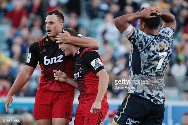 Israel Dagg of the Crusaders and Andy Ellis of the Crusaders celebrate during the round nine Super Rugby match between the Brumbies and the Crusaders...