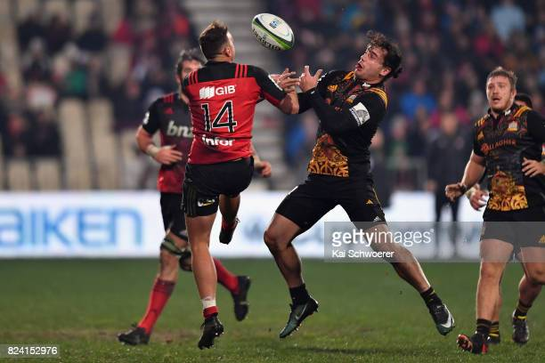 Israel Dagg of the Crusaders and James Lowe of the Chiefs compete for the ball during the Super Rugby Semi Final match between the Crusaders and the...
