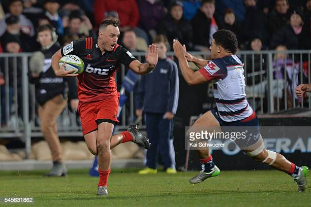 Israel Dagg of the Crusaders charges forward during the round 16 Super Rugby match between the Crusaders and the Rebels at AMI Stadium on July 9 2016...