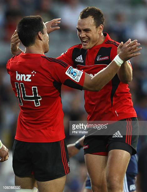 Israel Dagg of the Crusaders congratulates Sean Maitland on his try during the round one Super Rugby match between the Blues and the Crusaders at...