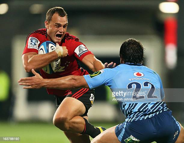 Israel Dagg of the Crusaders fending off Bulls player Jan Serfontein during the round five Super Rugby match between the Crusaders and the Bulls at...