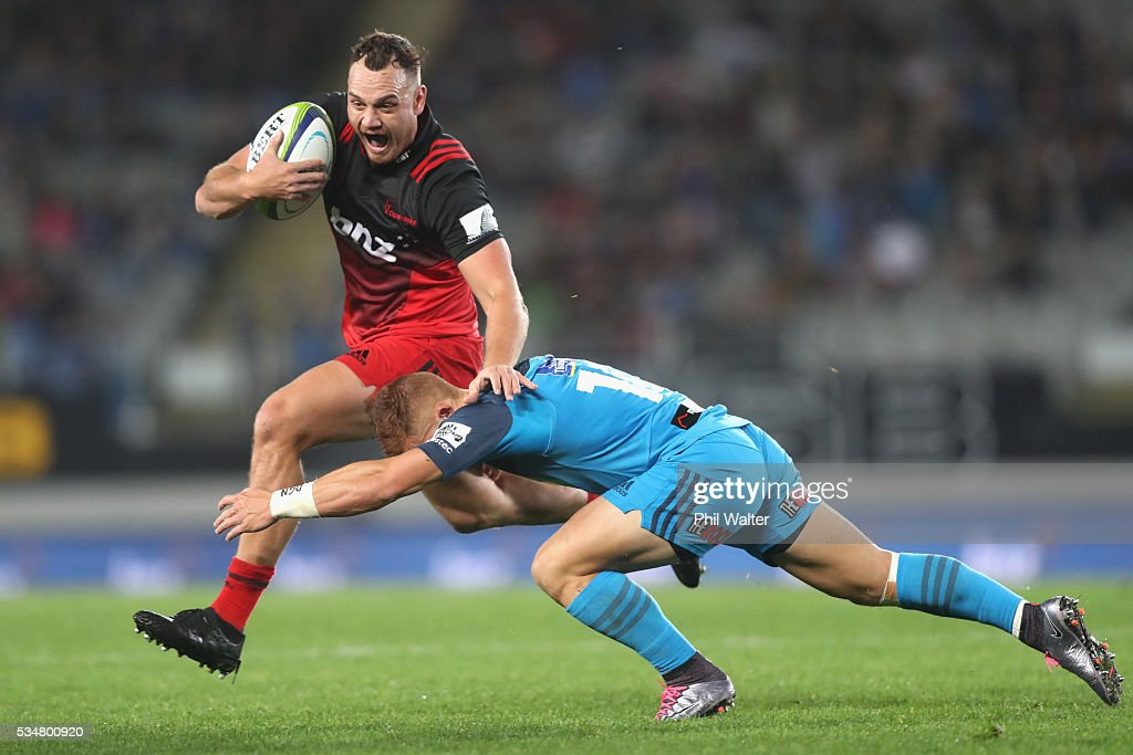 <a gi-track='captionPersonalityLinkClicked' href=/galleries/search?phrase=Israel+Dagg&family=editorial&specificpeople=2086281 ng-click='$event.stopPropagation()'>Israel Dagg</a> of the Crusaders is tackled by Ihaia West of the Blues during the round 14 Super Rugby match between the Blues and the Crusaders at Eden Park on May 28, 2016 in Auckland, New Zealand.