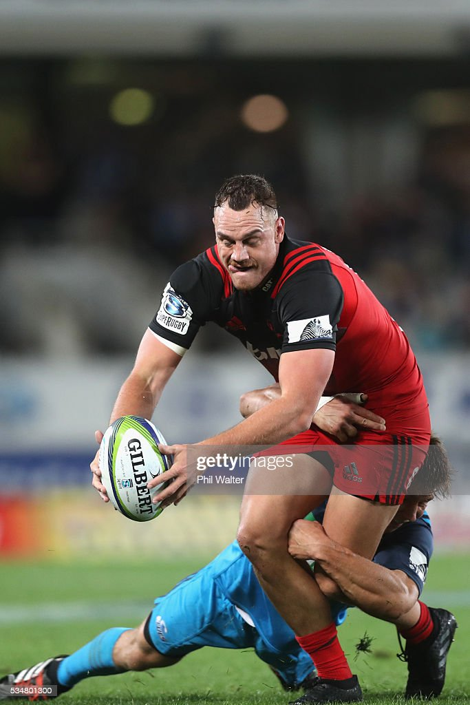 <a gi-track='captionPersonalityLinkClicked' href=/galleries/search?phrase=Israel+Dagg&family=editorial&specificpeople=2086281 ng-click='$event.stopPropagation()'>Israel Dagg</a> of the Crusaders is tackled during the round 14 Super Rugby match between the Blues and the Crusaders at Eden Park on May 28, 2016 in Auckland, New Zealand.