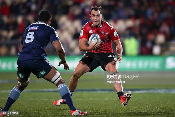 Israel Dagg of the Crusaders makes a break during the round 18 Super Rugby match between the Crusaders and the Blues at AMI Stadium on July 5 2014 in...
