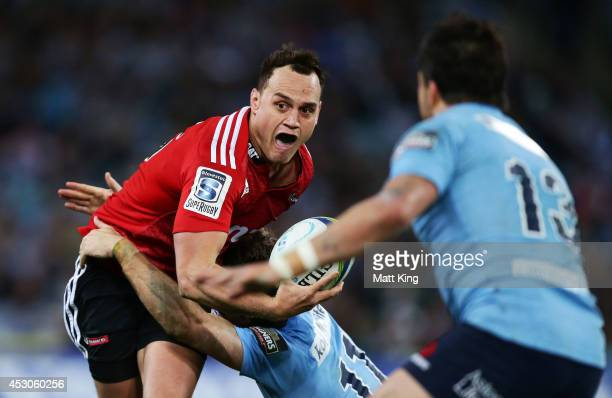 Israel Dagg of the Crusaders takes on the defence during the Super Rugby Grand Final match between the Waratahs and the Crusaders at ANZ Stadium on...