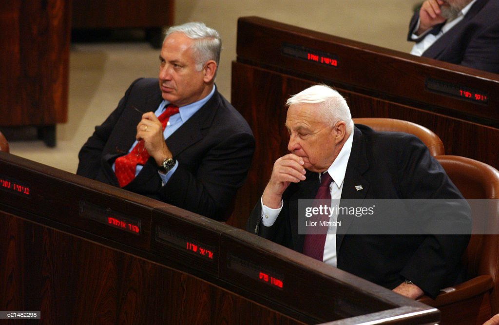 Israel Finance Minister Benjamin Netanyahu and Prime Minister Ariel Sharon are seen during the budget vote at the Knesset Israel's Parliament in...