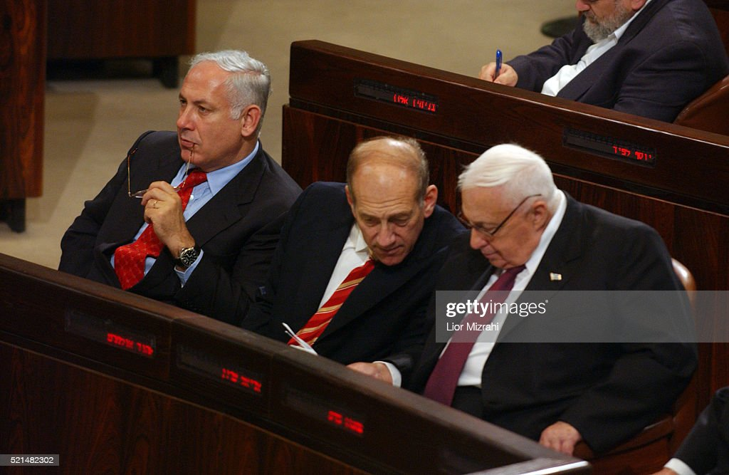 Israel Finance Minister Benjamin Netanyahu Prime Minister Ariel Sharon and Vice Premier Ehud Olmert are seen during the budget vote at the Knesset...