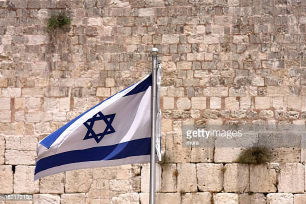 Israel flag in front of the Western wall