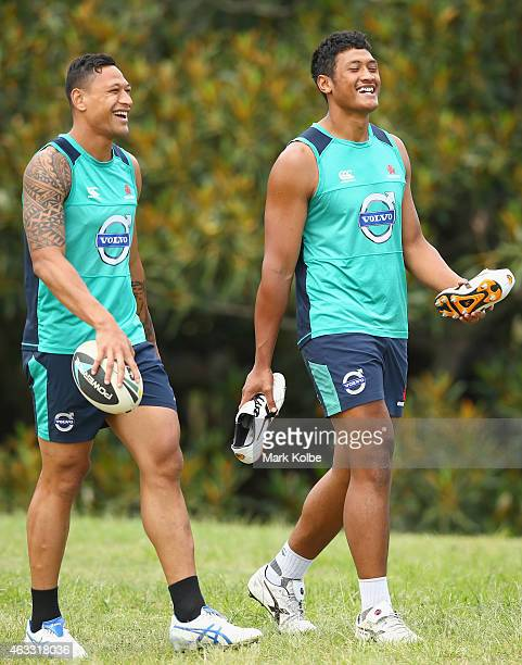 Israel Folau and Sam Lousi share a laugh as they arrive at training during a Waratahs Super Rugby training session at Allianz Stadium on February 13...