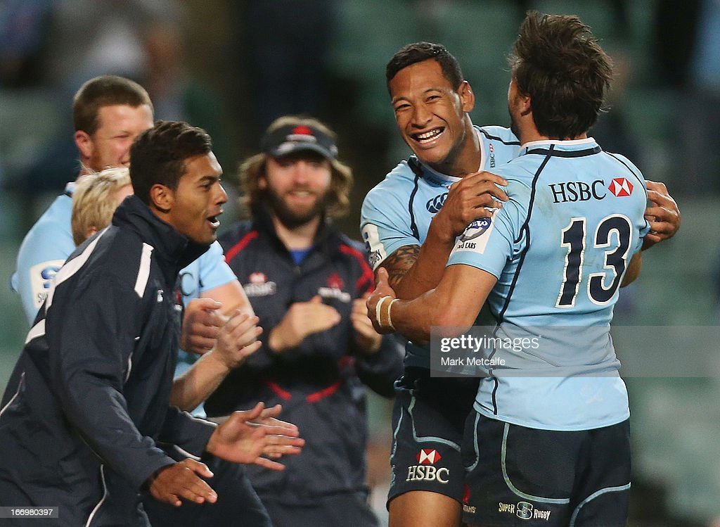 <a gi-track='captionPersonalityLinkClicked' href=/galleries/search?phrase=Israel+Folau&family=editorial&specificpeople=4194699 ng-click='$event.stopPropagation()'>Israel Folau</a> cof the Waratahs celebrates scoring a try with teammate <a gi-track='captionPersonalityLinkClicked' href=/galleries/search?phrase=Adam+Ashley-Cooper&family=editorial&specificpeople=637621 ng-click='$event.stopPropagation()'>Adam Ashley-Cooper</a> during the round 10 Super Rugby match between the Waratahs and the Chiefs at Allianz Stadium on April 19, 2013 in Sydney, Australia.
