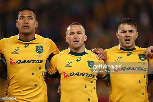 Israel Folau Matt Giteau and Drew Mitchell of the Wallabies sing the Australian national anthem during The Rugby Championship match between the...