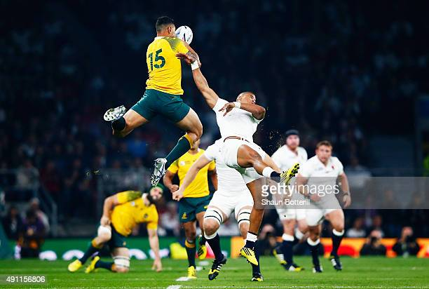 Israel Folau of Australia and Anthony Watson of England compete for the ball during the 2015 Rugby World Cup Pool A match between England and...