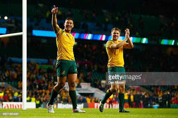 Israel Folau of Australia and Drew Mitchell celebrate victory after the 2015 Rugby World Cup Pool A match between Australia and Wales at Twickenham...