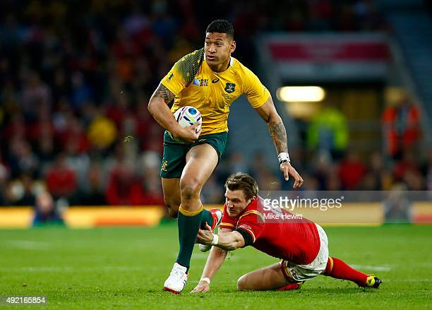 Israel Folau of Australia evades a tackle by Dan Biggar of Wales during the 2015 Rugby World Cup Pool A match between Australia and Wales at...