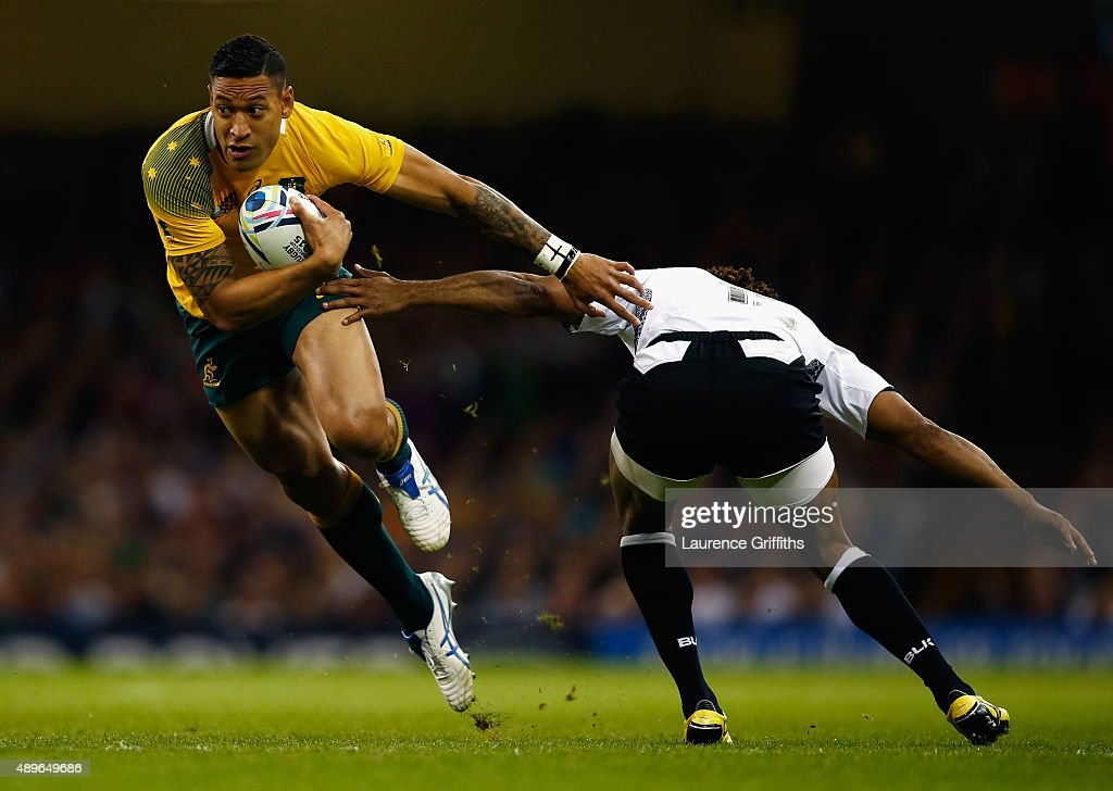 <a gi-track='captionPersonalityLinkClicked' href=/galleries/search?phrase=Israel+Folau&family=editorial&specificpeople=4194699 ng-click='$event.stopPropagation()'>Israel Folau</a> of Australia hands off <a gi-track='captionPersonalityLinkClicked' href=/galleries/search?phrase=Metuisela+Talebula&family=editorial&specificpeople=7799378 ng-click='$event.stopPropagation()'>Metuisela Talebula</a> of Fiji during the 2015 Rugby World Cup Pool A match between Australia and Fiji at the Millennium Stadium on September 23, 2015 in Cardiff, United Kingdom.