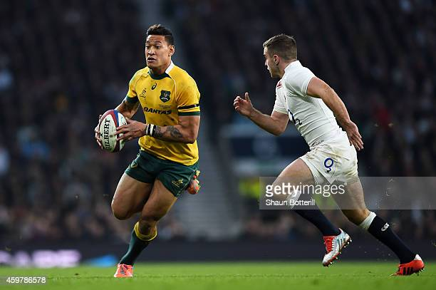 Israel Folau of Australia is closed down by George Ford of England during the QBE international match between England and Australia at Twickenham...