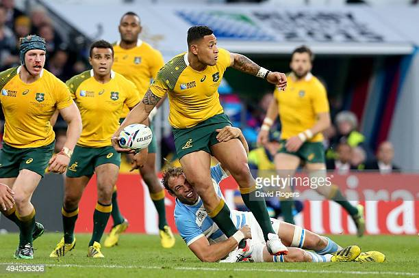 Israel Folau of Australia is tackled by Leonardo Senatore of Argentina during the 2015 Rugby World Cup Semi Final match between Argentina and...