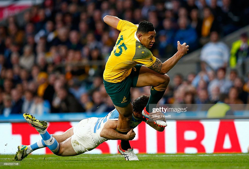 Israel Folau of Australia is tackled by Ramiro Herrera of Argentina during the 2015 Rugby World Cup Semi Final match between Argentina and Australia...