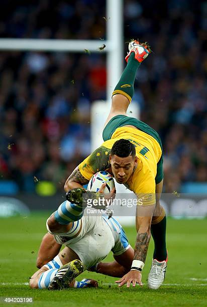 Israel Folau of Australia is tackled by Tomas Lavanini of Argentina which results in Lavanini being down shown a yellow card and sent to sin bin...