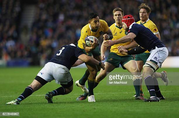 Israel Folau of Australia is tackled by Zander Fagerson of Scotland during the Scotland v Australia Autumn Test Match at Murrayfield Stadium on...