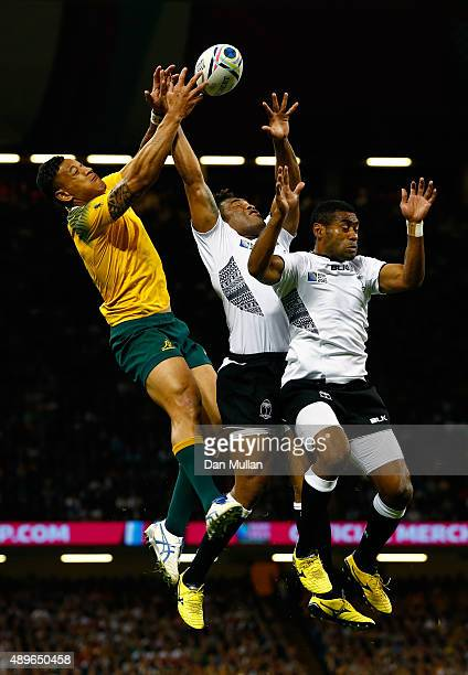 Israel Folau of Australia jumps for the ball with Metuisela Talebula and Asaeli Tikoirotuma of Fiji during the 2015 Rugby World Cup Pool A match...