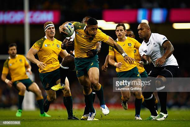 Israel Folau of Australia makes a break during the 2015 Rugby World Cup Pool A match between Australia and Fiji at the Millennium Stadium on...