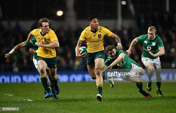 Israel Folau of Australia makes a break past Garry Ringrose of Ireland during the international match between Ireland and Australia at the Aviva...