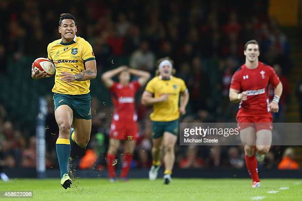 Israel Folau of Australia sprints clear to score his sides second try during the International match between Wales and Australia at the Millennium...
