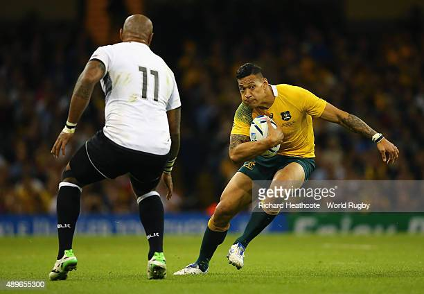 Israel Folau of Australia tries to avoid Nemani Nadolo of Fiji during the 2015 Rugby World Cup Pool A match between Australia and Fiji at the...