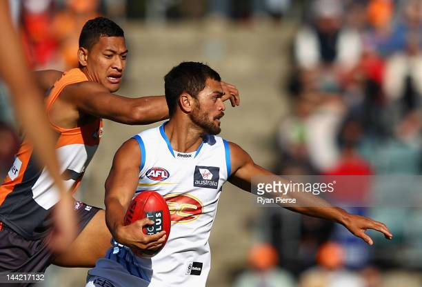 Israel Folau of the Giants competes for the ball against Karmichael Hunt of the Suns during the round seven AFL match between the Greater Western...