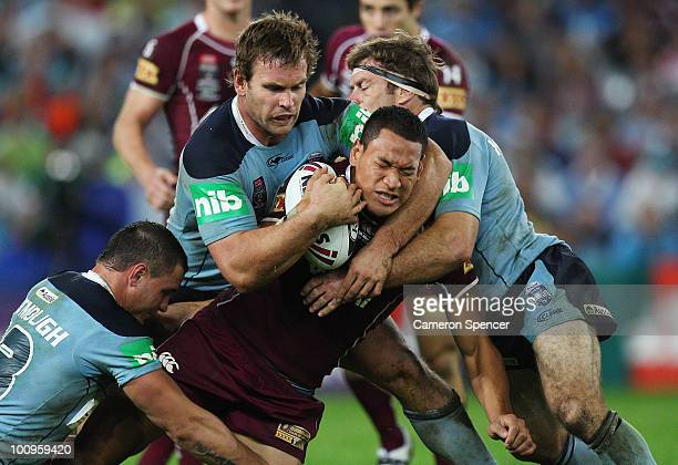Israel Folau of the Maroons is tackled by Josh Perry and Brett Kimmorley of the Blues during game one of the ARL State of Origin series between the...