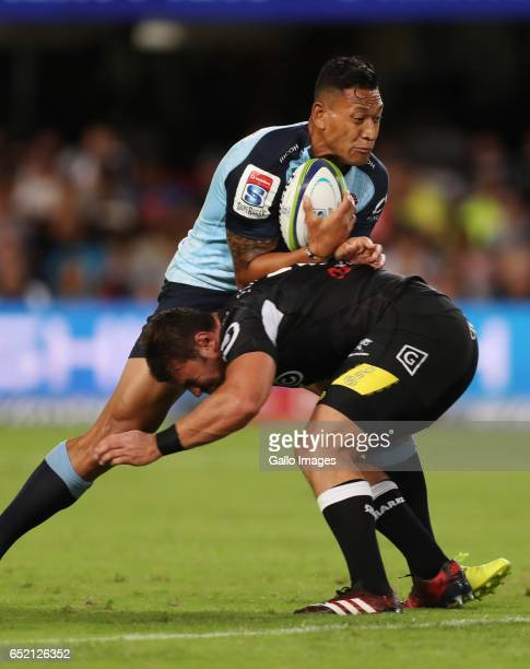 Israel Folau of the NSW Waratahs tackled by Franco Marais of the Cell C Sharks during the Super Rugby match between the Cell C Sharks and Waratahs at...