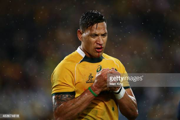 Israel Folau of the Wallabies attends to a face injury after a cillision with Nic White during The Rugby Championship match between the Australian...