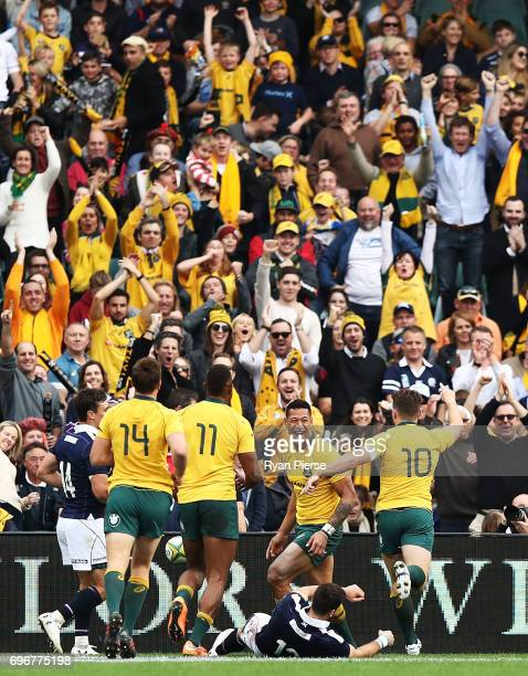 Israel Folau of the Wallabies celebrates after scoring a try during the International Test match between the Australian Wallabies and Scotland at...