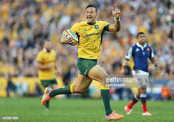 Israel Folau of the Wallabies celebrates as he runs in to score a try during the International Test match between the Australia Wallabies and France...