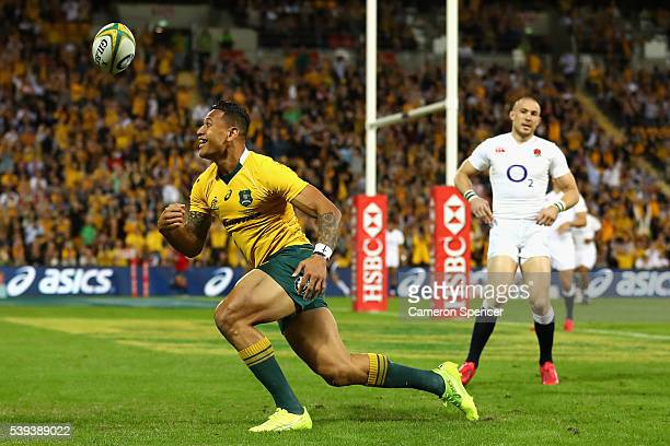 Israel Folau of the Wallabies celebrates scoring a try during the International Test match between the Australian Wallabies and England at Suncorp...