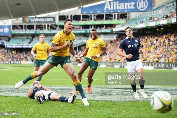 Israel Folau of the Wallabies celebrates scoring a try during the International Test match between the Australian Wallabies and Scotland at Allianz...