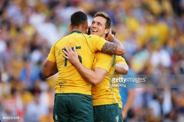 Israel Folau of the Wallabies celebrates with Dane HaylettPetty after scoring a try during the International Test match between the Australian...