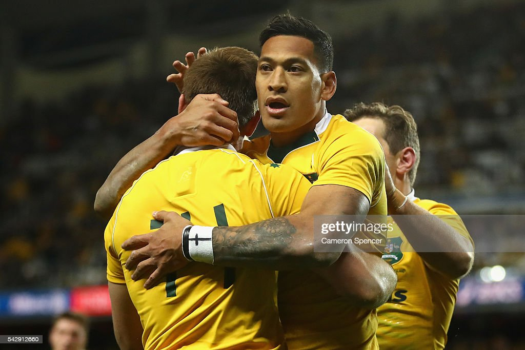 Israel Folau of the Wallabies congratulates team mate Dane Haylett-Petty of the Wallabies after scoring a try during the International Test match between the Australian Wallabies and England at Allianz Stadium on June 25, 2016 in Sydney, Australia.