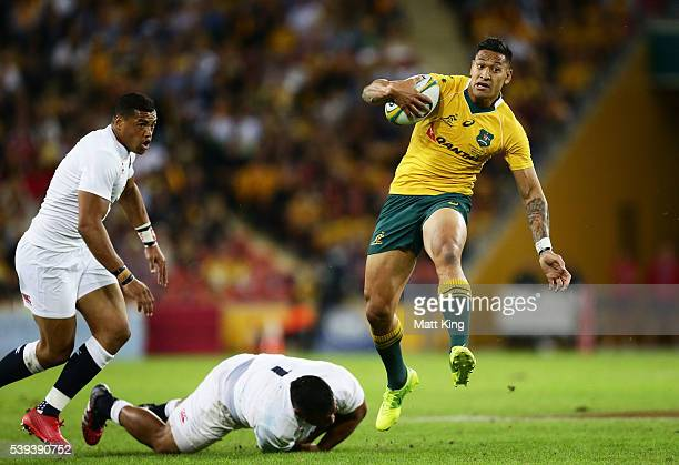 Israel Folau of the Wallabies evades a tackle during the International Test match between the Australian Wallabies and England at Suncorp Stadium on...